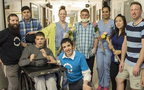 Visitors from the Friendship Circle volunteer to bring smiles and flowers to patients and staff in Pavilion K.
