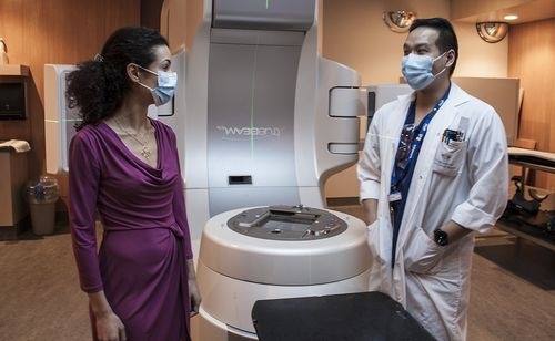 Dr. Magali Lecavalier-Barsoum consults with Technologist Dennis Ip about the linear accelerator in the Division of Radiation Oncology.