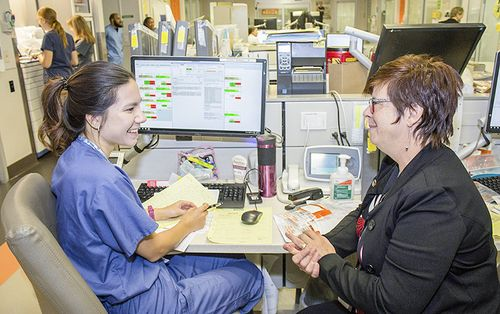 In the JGH Emergency Department, Lucie Tremblay, Director of Nursing, chats informally with Nurse Clinician Valerie Lok, who presents her own unique perspective on the department's day-to-day successes and difficulties