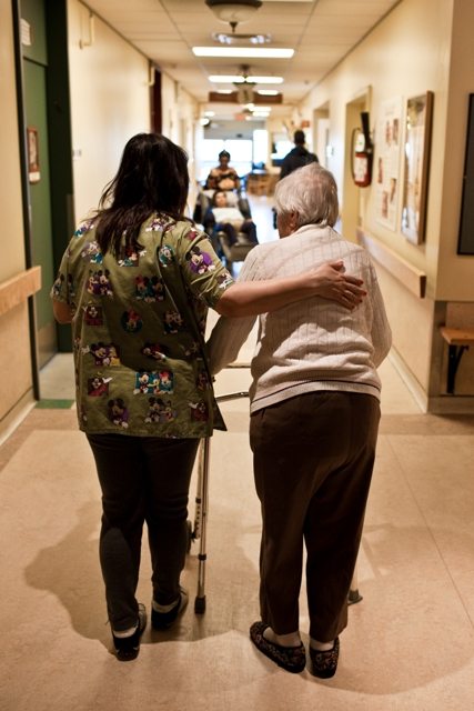 A beneficiary attendant walking with a resident in a long-term care facility of CIUSSS West-Central Montreal